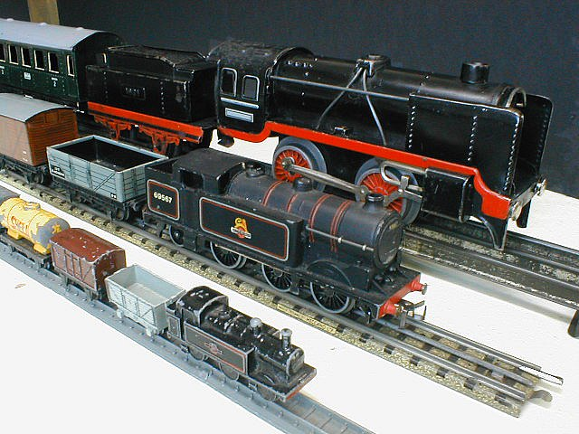 Model trains in o gauge rear oo gauge middle and ooo gauge front